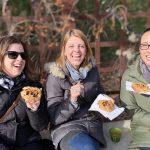 Three people enjoying pastries in Elora, Ontario